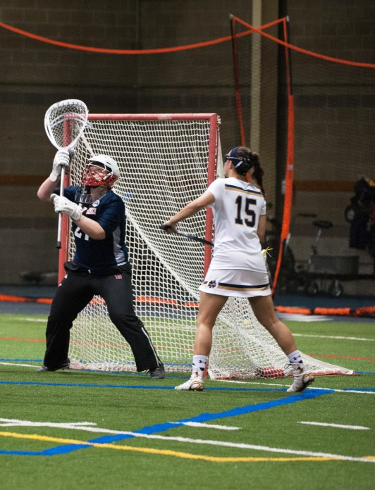 Irish senior attack Cortney Fortunato watches a shot during Notre Dame's 24-9 win over Detroit at Loftus Sports Center on Feb. 11.