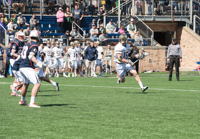 Irish senior midfielder Sergio Perkovic runs across the field during Notre Dame's 11-10 loss to Syracuse on April 1 at Arlotta Stadium.