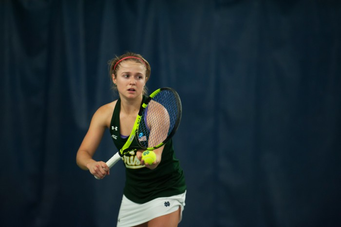 Irish senior captain Monica Robinson prepares to serve during Notre Dame's 5-2 win over Purdue on Feb. 22 at Eck Tennis Pavilion.