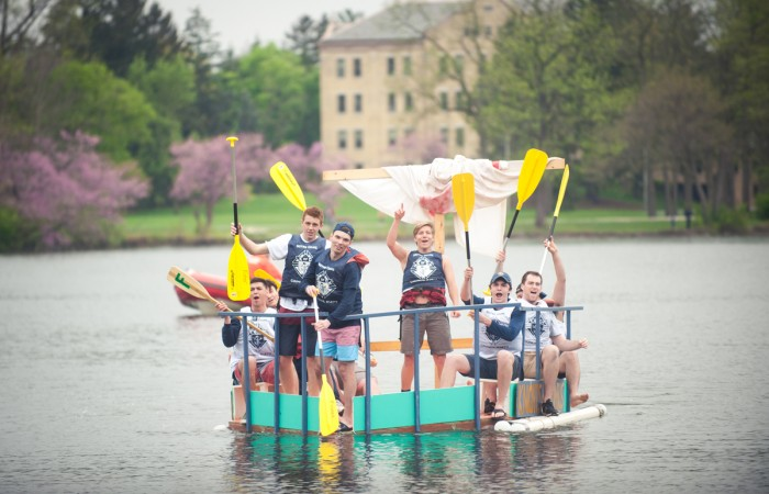 """Participants travel across St. Mary's Lake during Saturday's event. A team of freshmen from Fisher Hall won this year's Fisher Regatta with their boat """"Floaty McFloatface."""""""