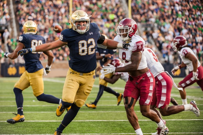 Irish senior tight end Nic Weishar looks to create separation as he runs a route during Notre Dame's 49-16 win over Temple on Saturday at Notre Dame Stadium. Weishar caught his first career touchdown reception in the first quarter of the win for the Irish.