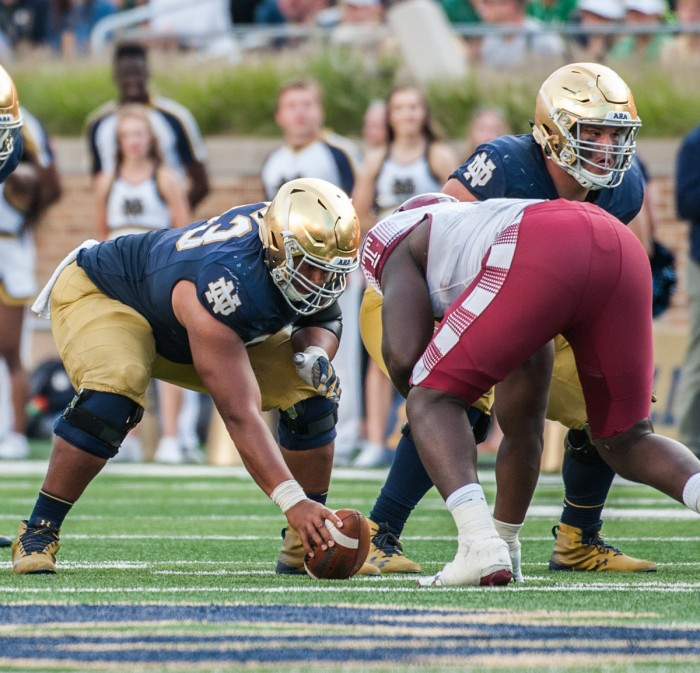 Irish senior center Sam Mustipher prepares to snap the ball during Notre Dame's 49-16 win over Temple on Saturday at Notre Dame Stadium.
