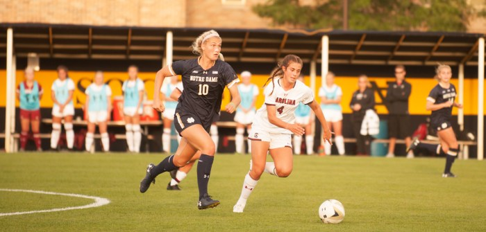 Irish sophomore forward Jennifer Westendorf battles for the ball during Notre Dame's 1-0 loss to South Carolina in double overtime Friday at Alumni Stadium. Westendorf took four shots on goal during the goal, but was unable to covert. She leads the team in points on the season with seven: two goals and three assists.
