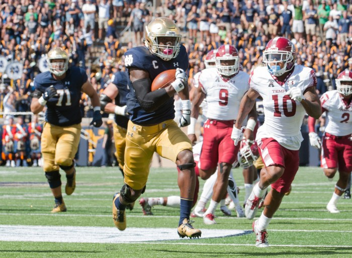 Josh Adams runs upfield during Notre Dame's 49-16 win over Temple on Saturday at Notre Dame Stadium. Adams has nine 100-yard rushing performances over the course of his Notre Dame career.