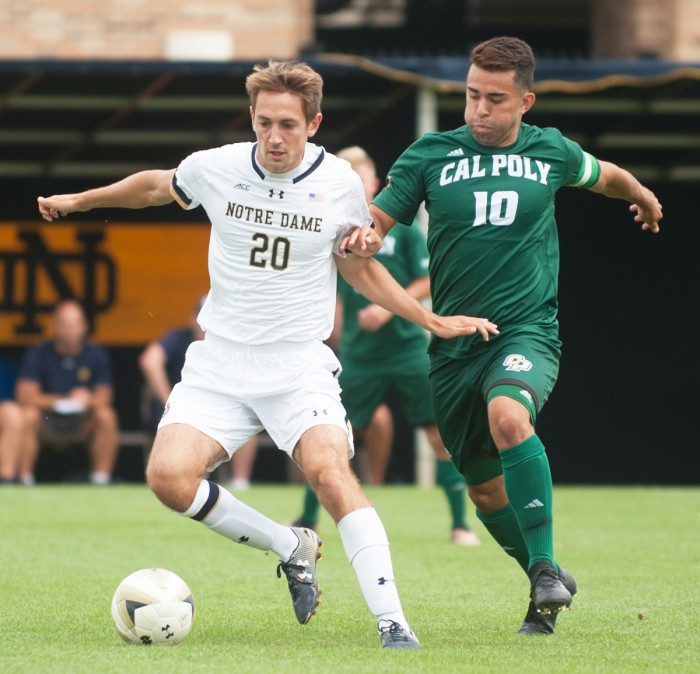 Irish senior midfielder Blake Townes dribbles around the defense during Notre Dame's 2-1 double overtime victory over Cal Poly on Aug. 27 at Alumni Stadium.