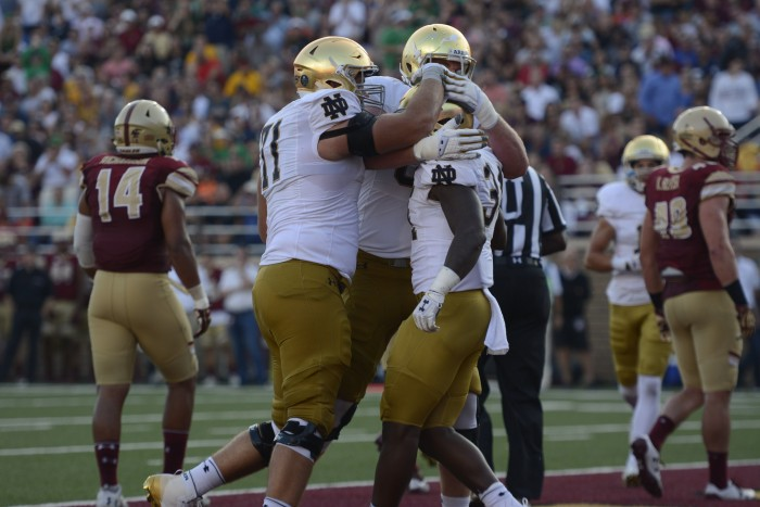Irish sophomore running back Tony Jones Jr. celebrates with his teammates during Notre Dame's 49-20 win over Boston College on Saturday.