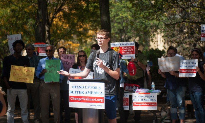 "A student speaks at Monday's ""Making Change at Walmart"" rally on Monday at Fieldhouse Mall."