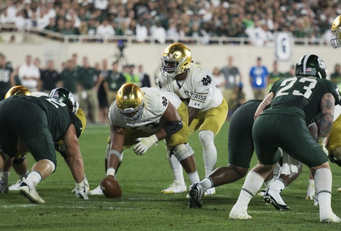 Irish junior quarterback Brandon Wimbush prepares to take a snap during Notre Dame's 38-18 win over Michigan State at Spartan Stadium in East Lansing, Michigan, on Saturday.