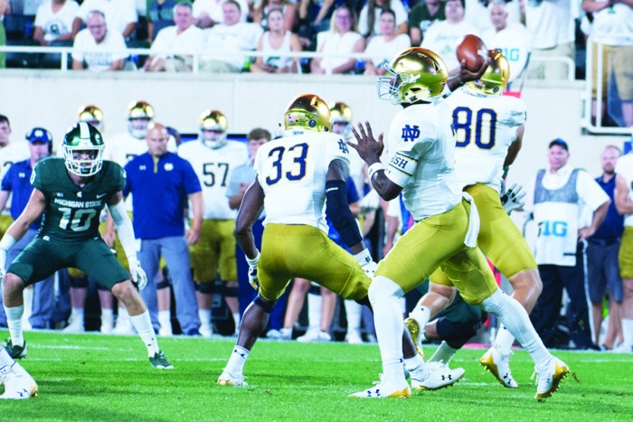 Irish junior quarterback passes the ball during Notre Dame's 38-18 win over Michigan State on Saturday in East Lansing, Michigan.