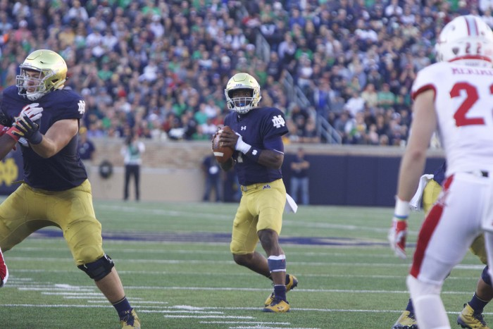 Irish junior quarterback Brandon Wimbush drops back to pass during Notre Dame's 52-17 win over Miami (OH) on Saturday at Notre Dame Stadium.