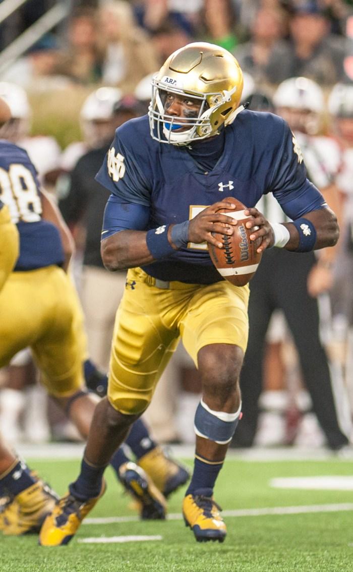 Irish junior quarterback Brandon Wimbush scrambles with the ball during Notre Dame's 52-17 win over Miami (OH) on Saturday at Notre Dame Stadium.