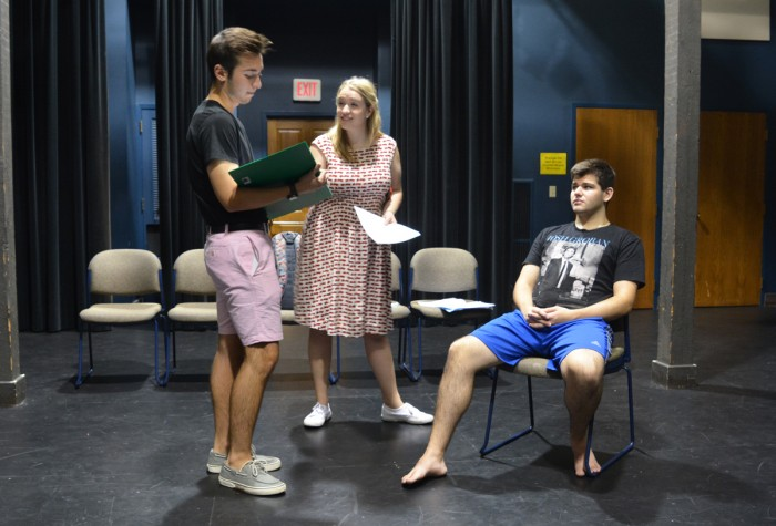 "Cast members rehearse for PEMCo's production of ""A New Brain"", while director Caroline Lezny looks on. The play will run from October 5-7 in Washington Hall."