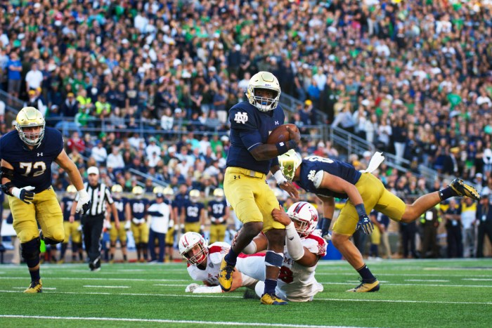 Irish junior quarterback Brandon Wimbush breaks away from a defender during Notre Dame's 52-17 win over Miami (OH) on Saturday at Notre Dame Stadium.