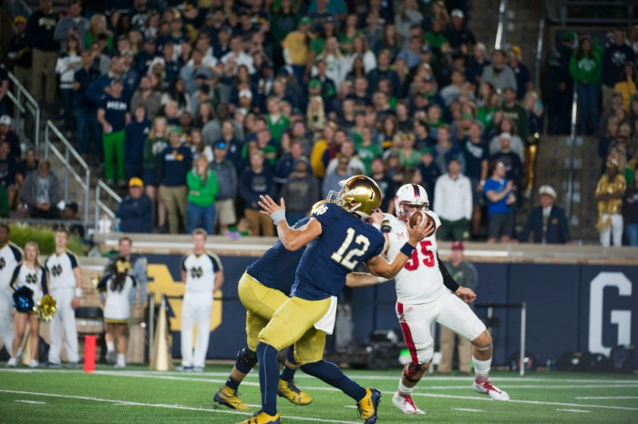 Irish sophomore quarterback Ian Book fires a pass during Notre Dame's 52-17 win over Miami (OH) on Saturday at Notre Dame Stadium.