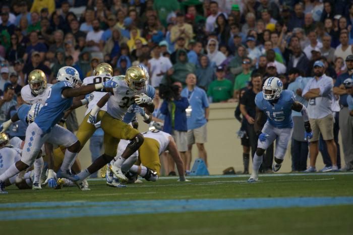 Irish junior running back Josh Adams breaks away from a defender during Notre Dame's 33-10 win over North Carolina on Saturday at Kenan Memorial Stadium in Chapel Hill, North Carolina.