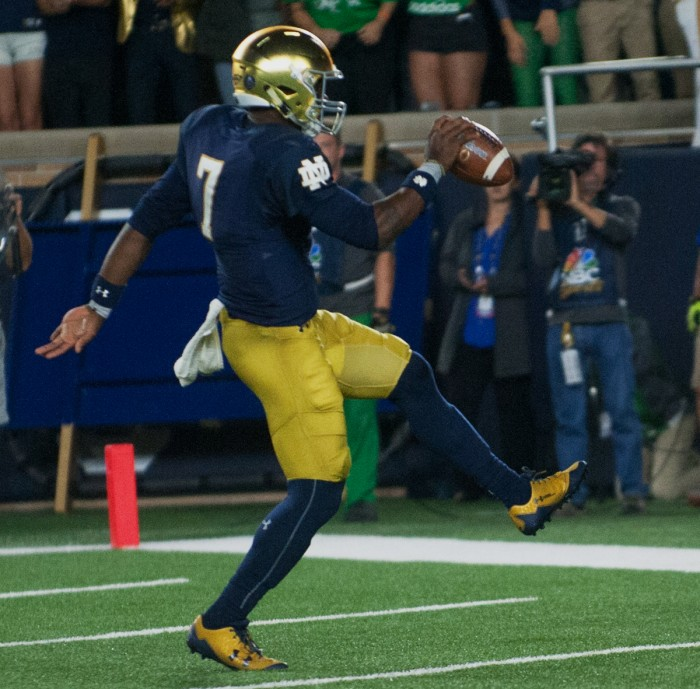 Irish junior quarterback Brandon Wimbush scampers into the endzone after a touchdown run during Notre Dame's 49-14 win over USC on Saturday.