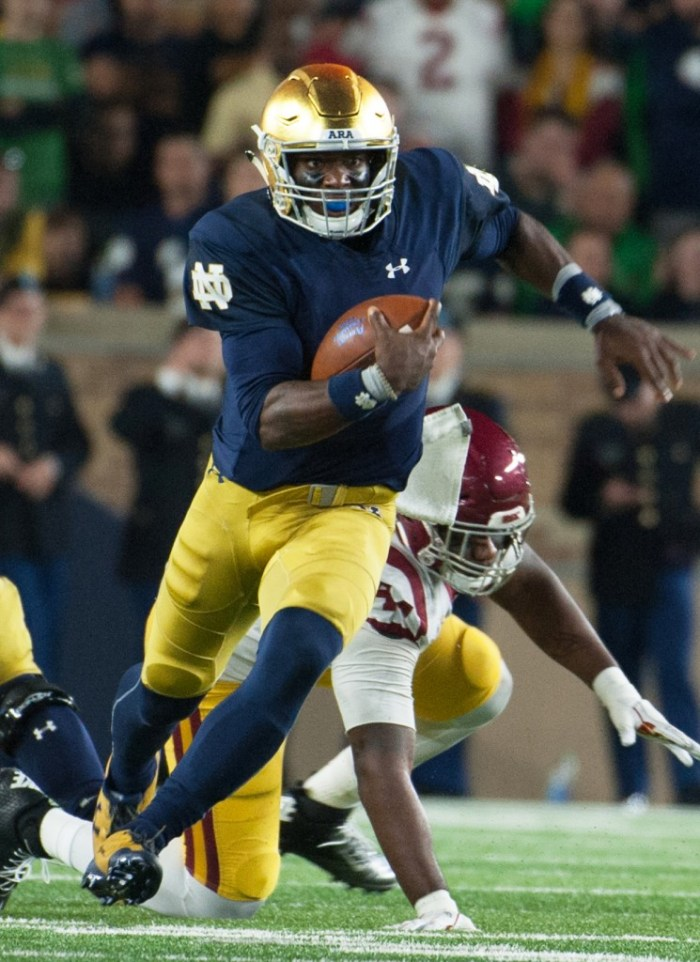 Irish junior quarterback Brandon Wimbush sprints down the field during Notre Dame's 49-14 victory over USC on Saturday at Notre Dame Stadium.