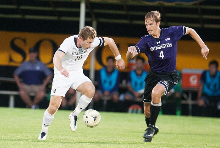 Irish senior forward Jon Gallagher evades a defender during Notre Dame's 2-1 overtime win over Northwestern on Oct. 3 at Alumni Stadium. The tri-captain scored the winning goal in overtime for the Irish.