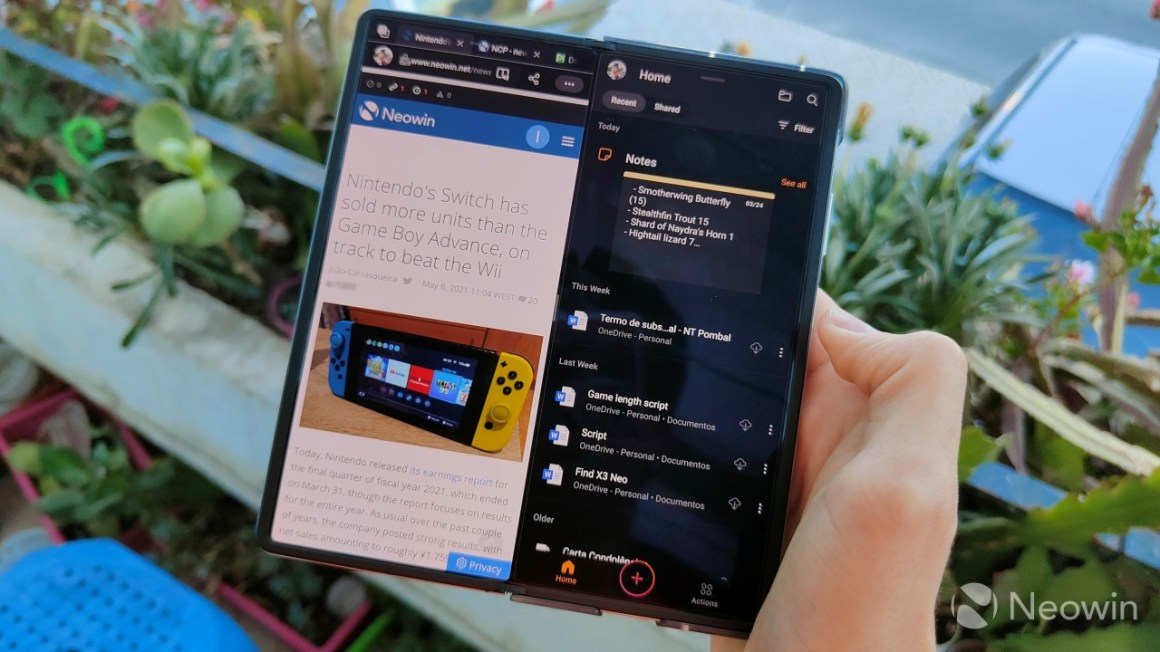 A Huawei Mate X2 with two apps open in split screen on the inner display