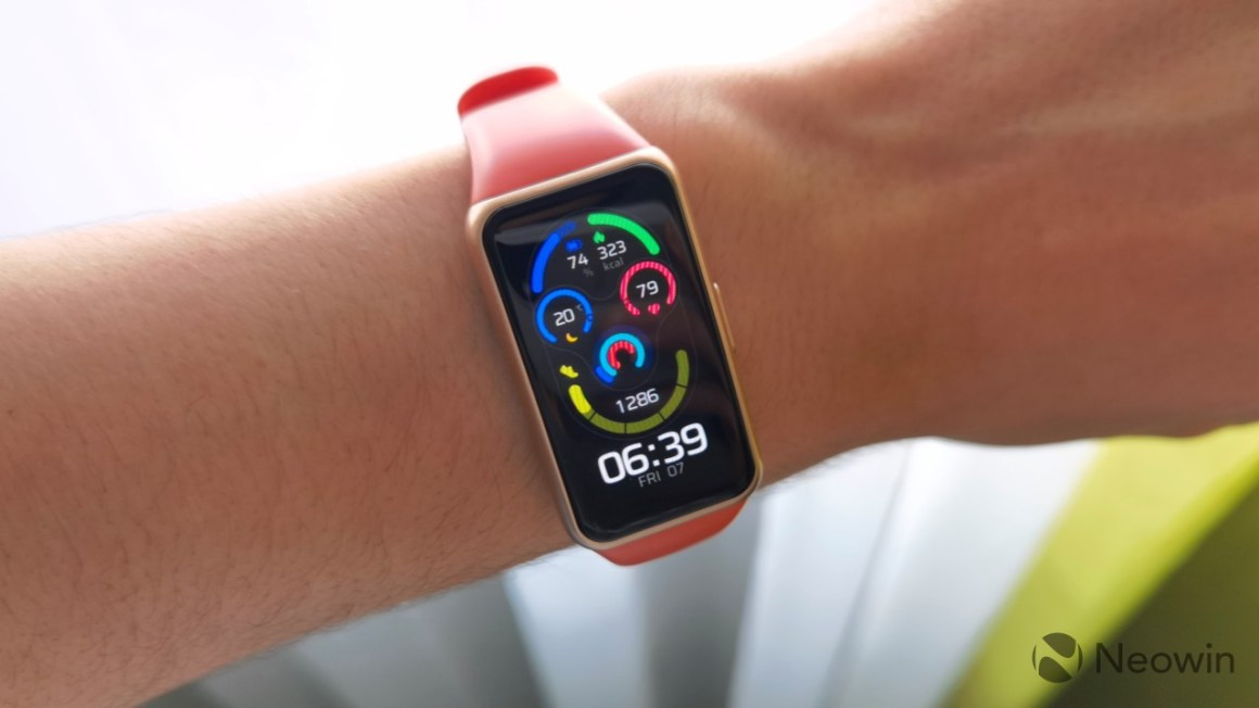 Huawei Band 6 on a wrist displaying the Mask watch face