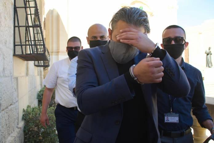 Aleksandar Stojanovic being escorted to court in Gozo