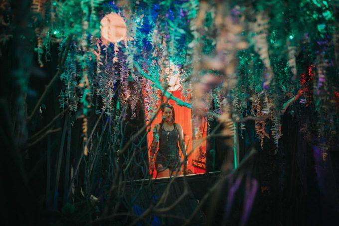 a woman walking through a surrealist museum