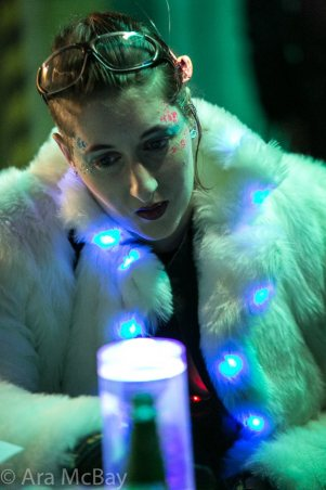 Person in white coat adorned in glowing lights