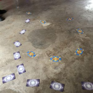 tarot cards face down on a concrete floor