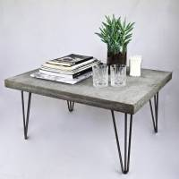 concrete coffee table with steel legs by sort cement