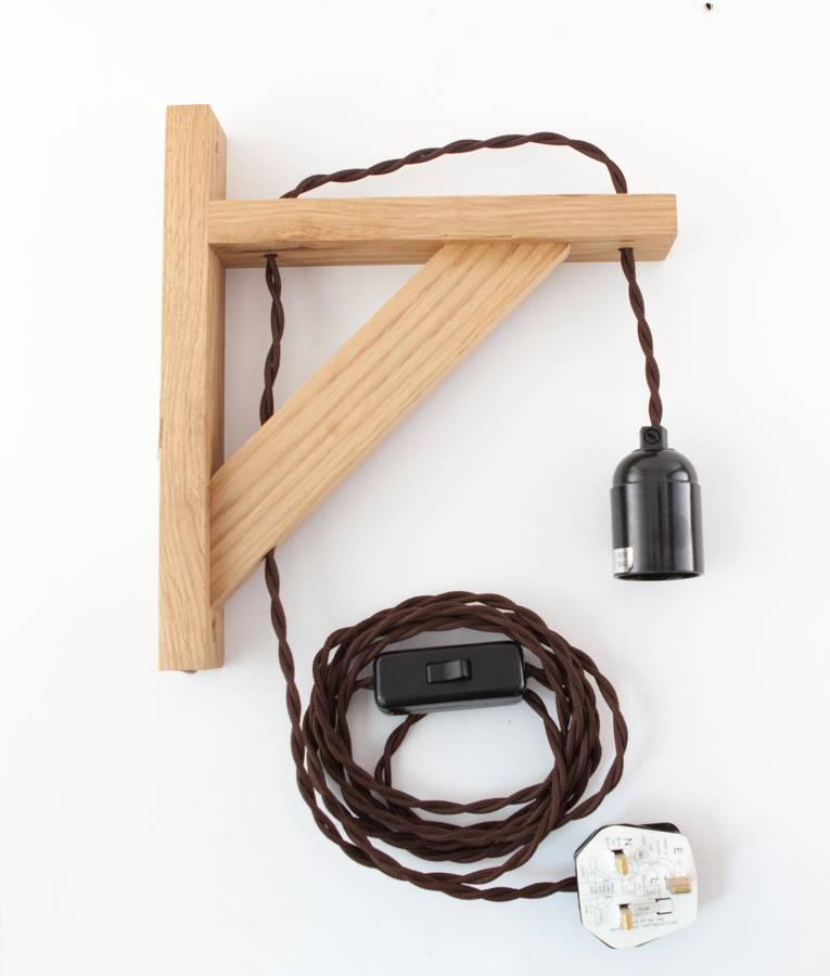 hebden oak wall bracket beside lamp wall light by dowsing