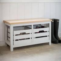 wooden bench with storage crates in chalk white by garden ...