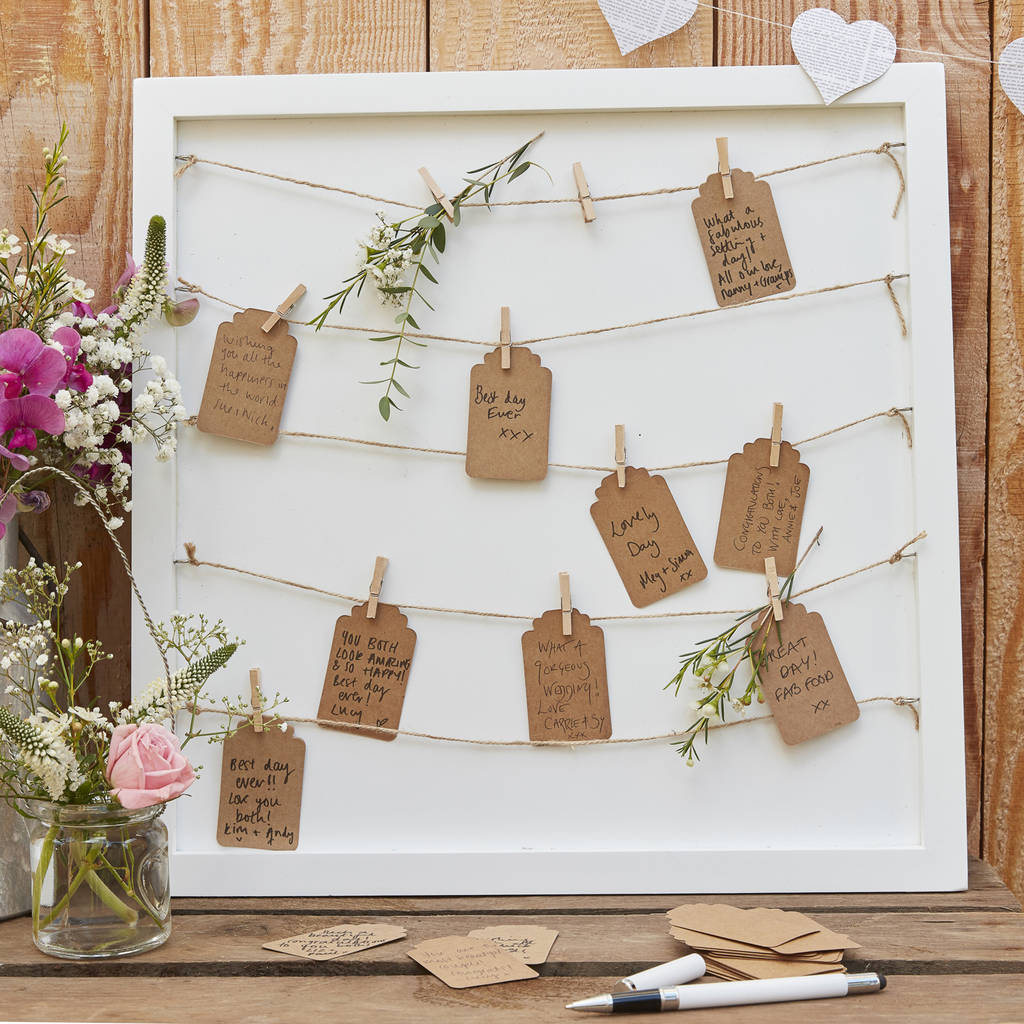 white wooden table plan  peg display board by the wedding