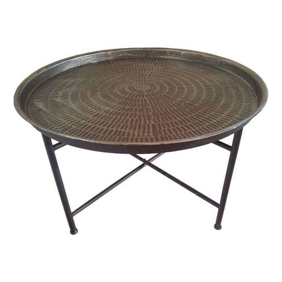 hammered metal coffee table by out there interiors