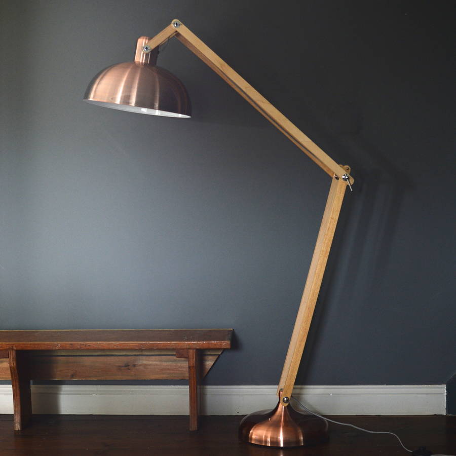 copper and wood floor lamp by the forest  co