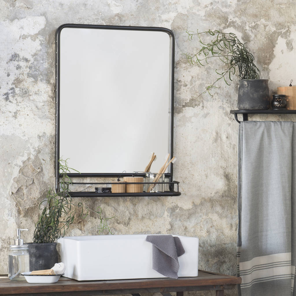 large black industrial mirror with shelf by the little