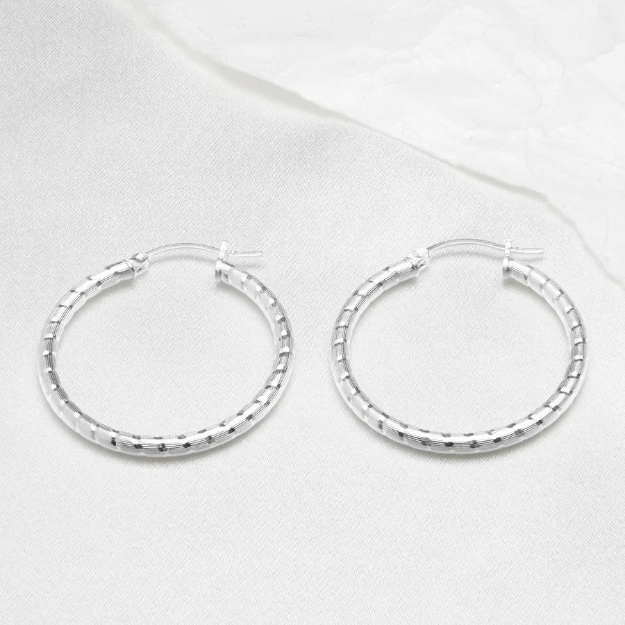 textured sterling silver hoop earring by the london