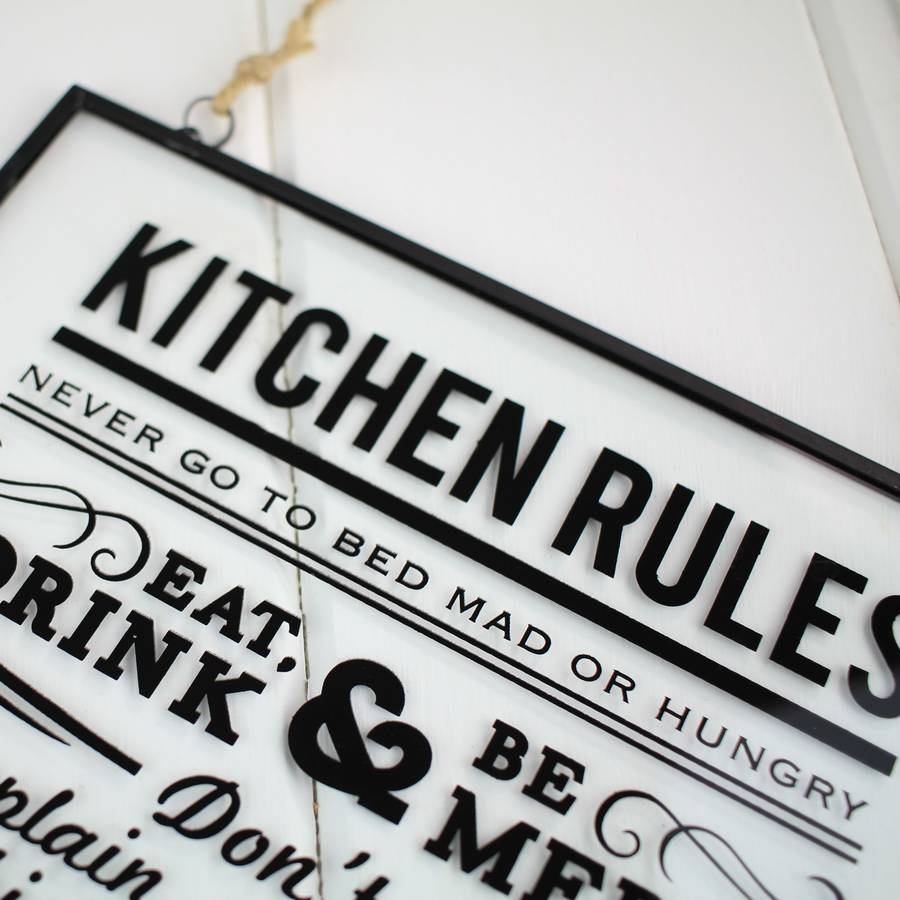kitchen rules hanging glass sign by nest