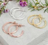 brushed gold or silver medium hoop earrings by auree