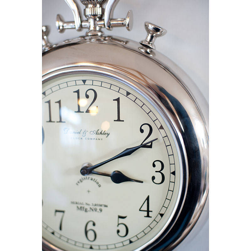 silver pocket watch wall clock by the orchard