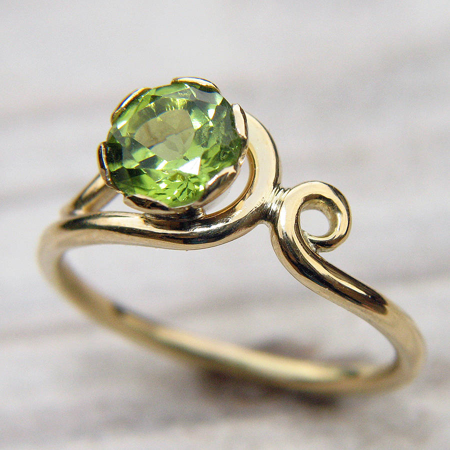 peridot art nouveau style ring in 18ct gold by lilia nash