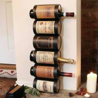 wall wine bottle holder by dibor | notonthehighstreet.com