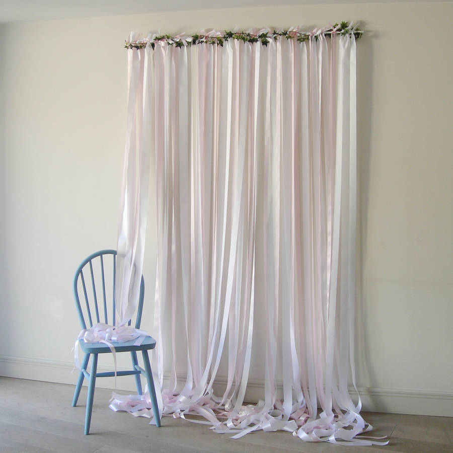 pale pink ribbon backdrop on white pole with ivy by just add a dress  notonthehighstreetcom