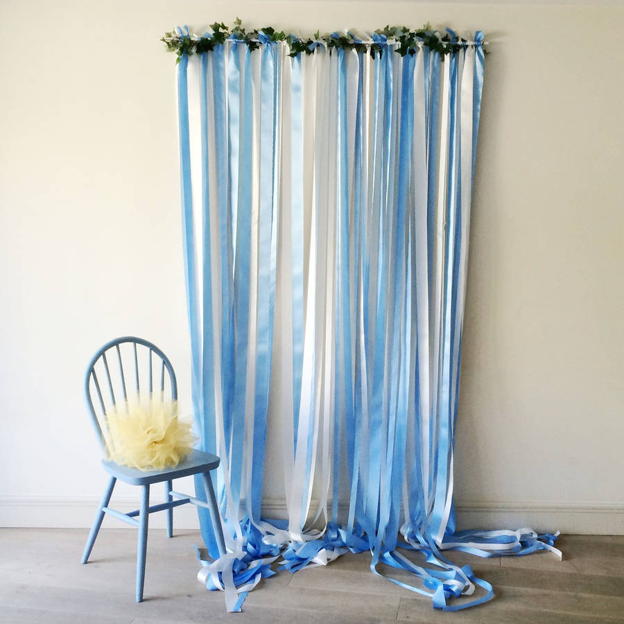 Blue Ribbon Backdrop On White Pole With Ivy Garland By Just Add A Dress