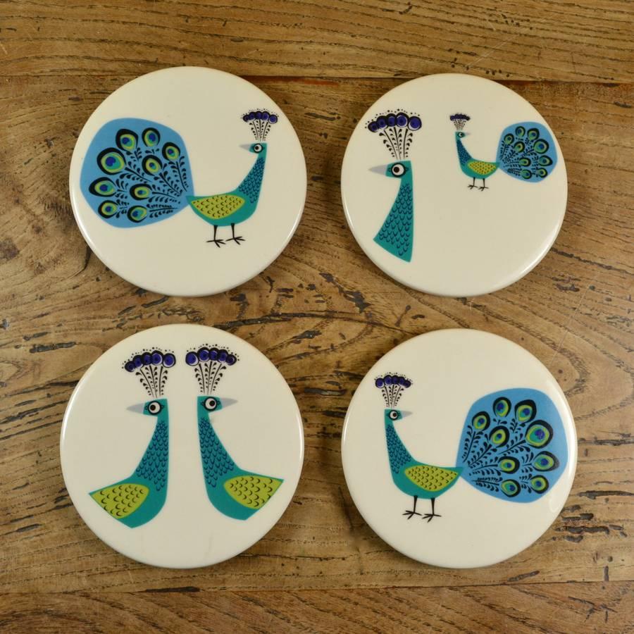 ceramic peacock coasters by hannah turner