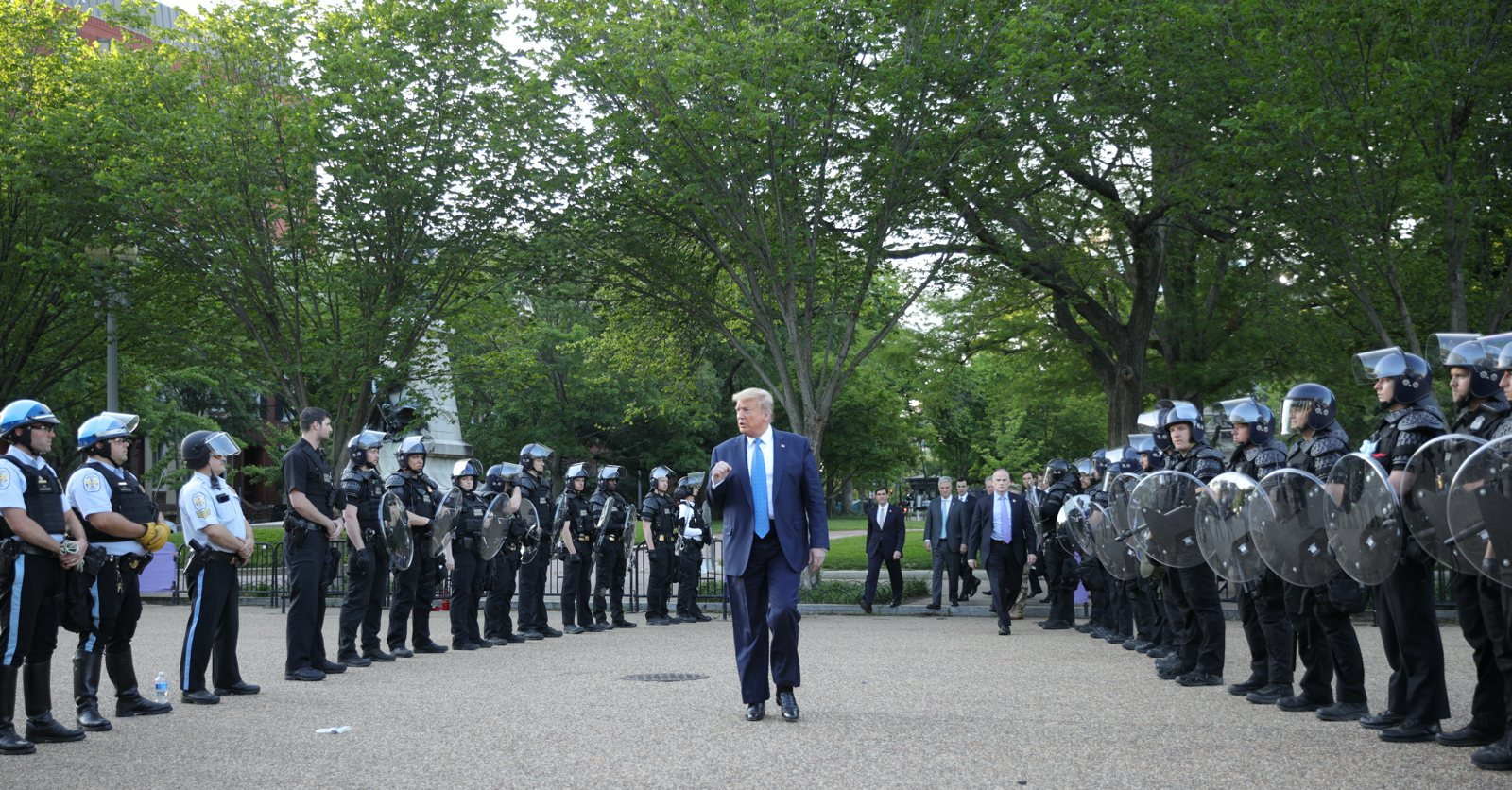 Donald Trump walking past riot police in Lafayette Park