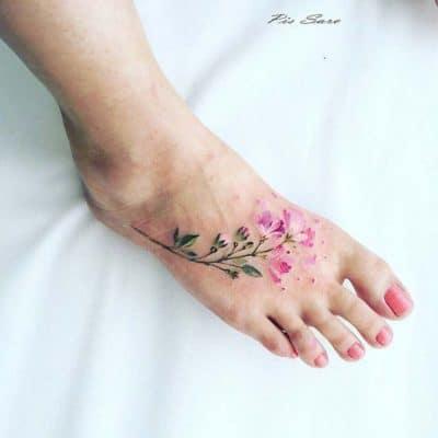 woman's vibrant floral foot tattoo