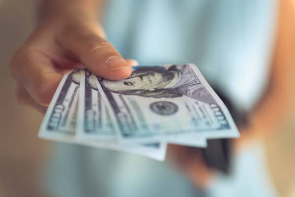 Cash purchases to avoid debts and financial distress