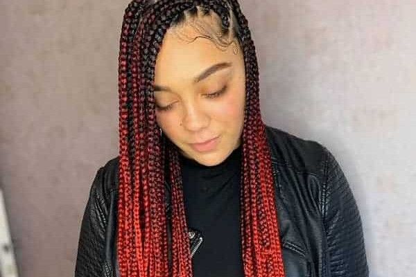 Grab all the attention with red knotless braid.
