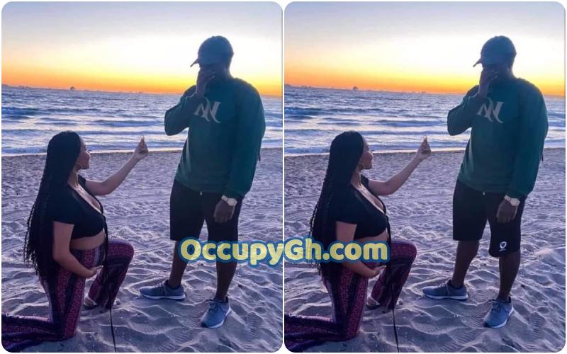 pregnant woman kneeling proposes man