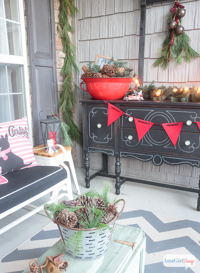 pinecones as part of front porch Christmas decor